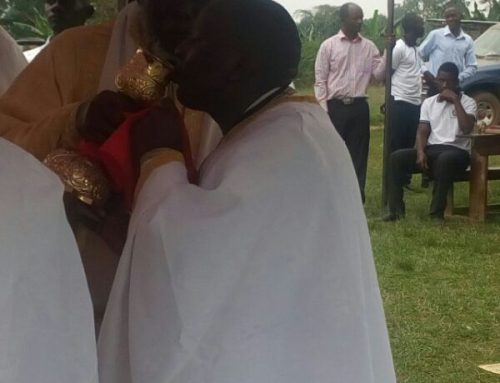 Fr Constantinos receiving Holy Communion from His Eminence Jonah Lwanga of Uganda