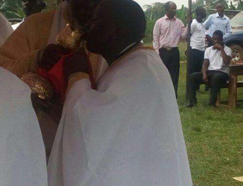 Fr Constantinos receiving Holy Communion from His Eminence Jonah Lwanga of Uganda