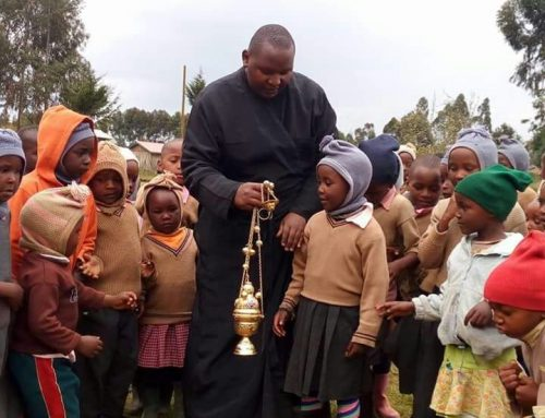 Fr Constantinos with kids demonstrating its use